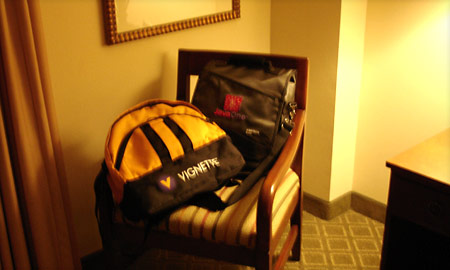 A photo of luggage on a hotel room chair