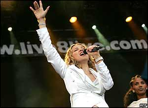 Madonna performing onstage at the Live 8 concert in Hyde Park, London as Birhan Woldu stands in the background
